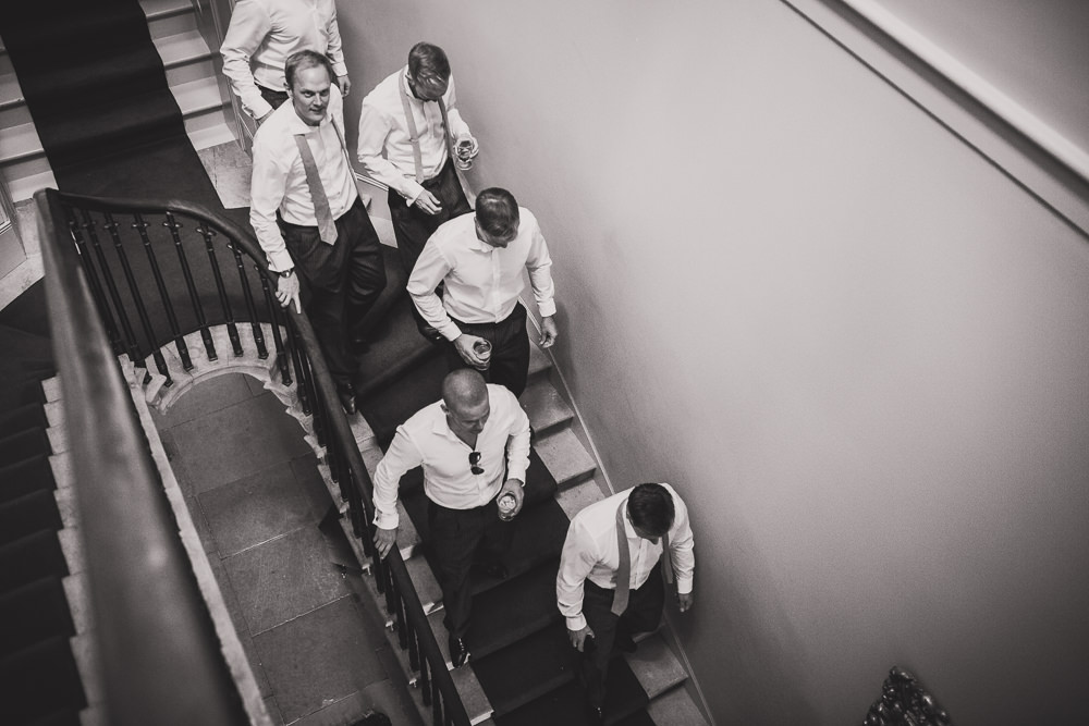 groomsmen walking down stairs