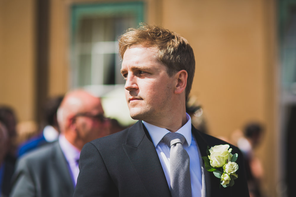 groom looking over shoulder