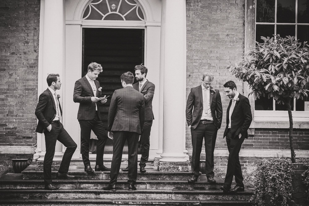 groom's party on steps