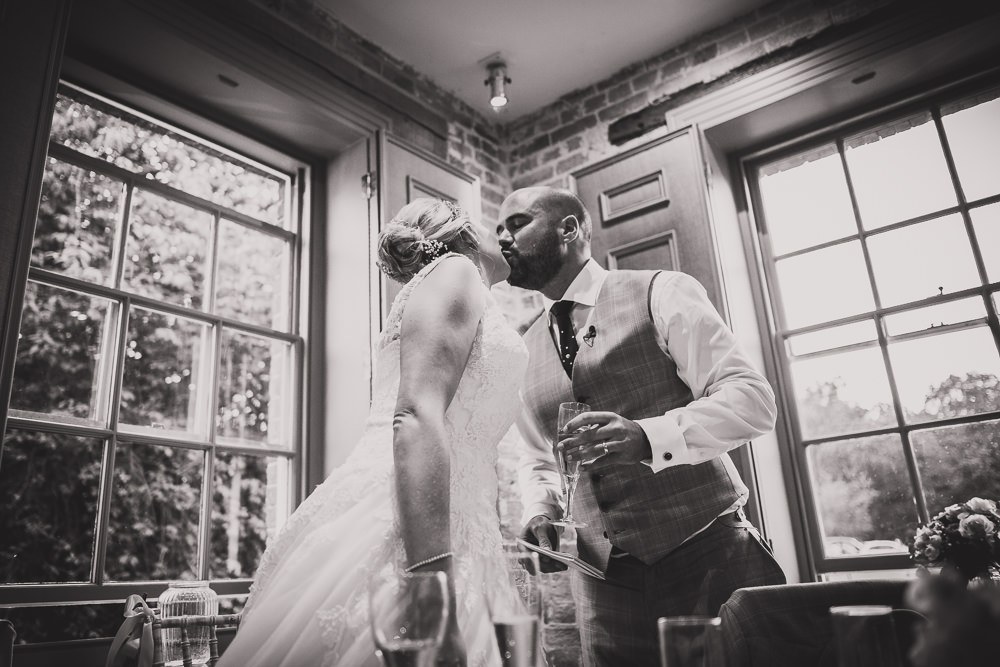 groom toasting wife
