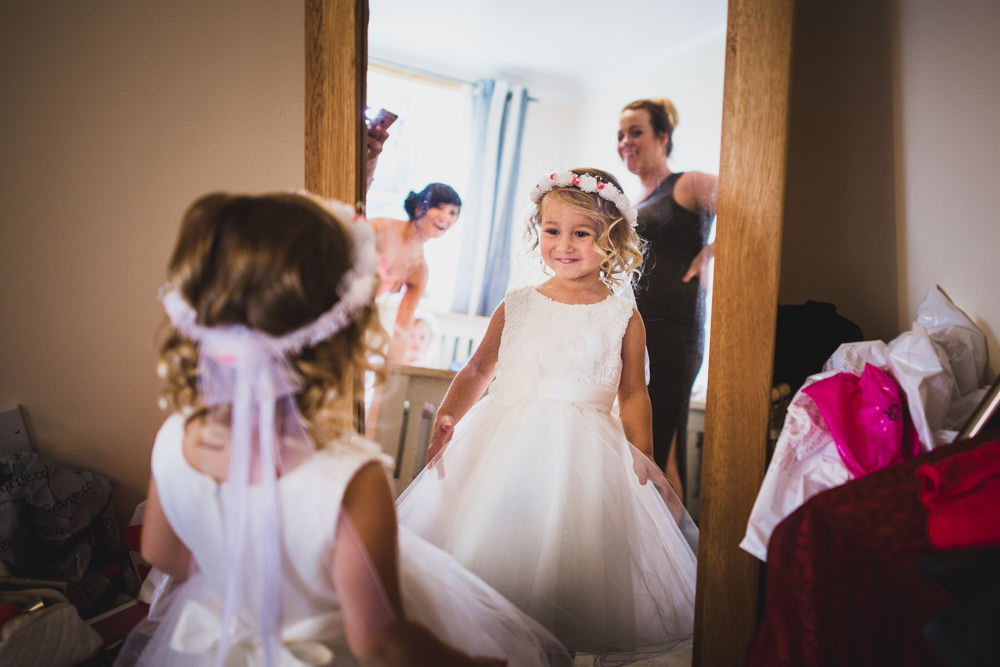 flower girl looking in mirror