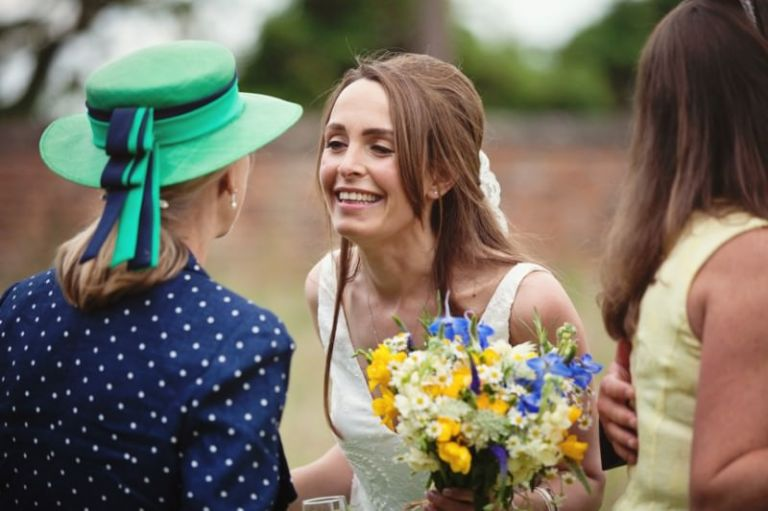 bride leaning in to kiss guest