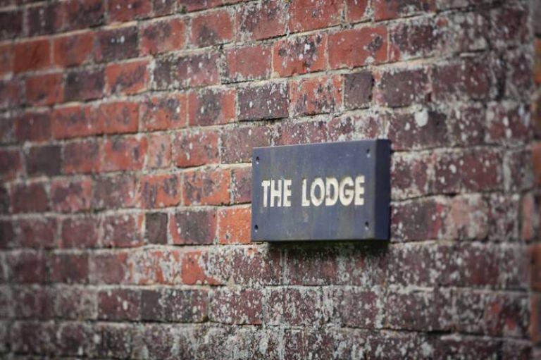 "venue gate sign ""the lodge"""