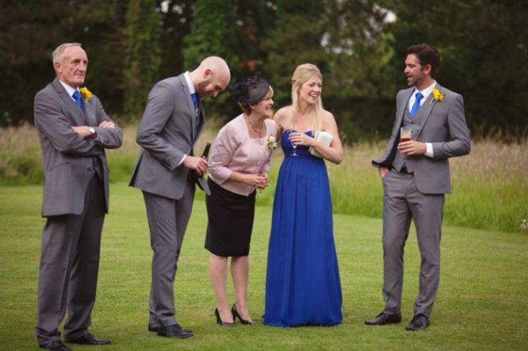bridal party sharing a joke