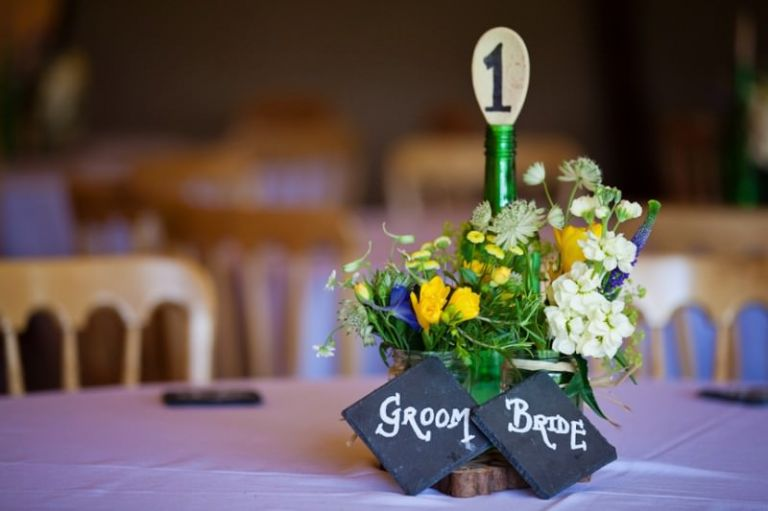 table centre piece with bride and groom slates