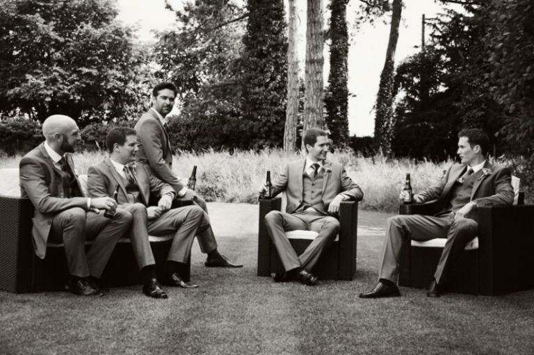 Groom's party enjoying a pre-wedding beer