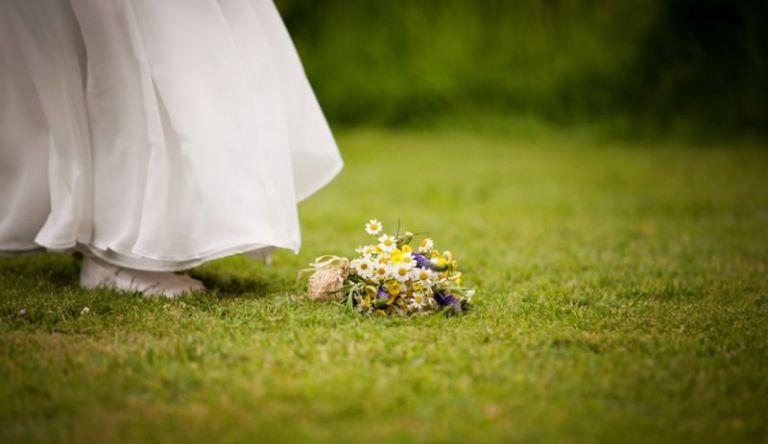 flower girl's bouquet on floor next to her feet