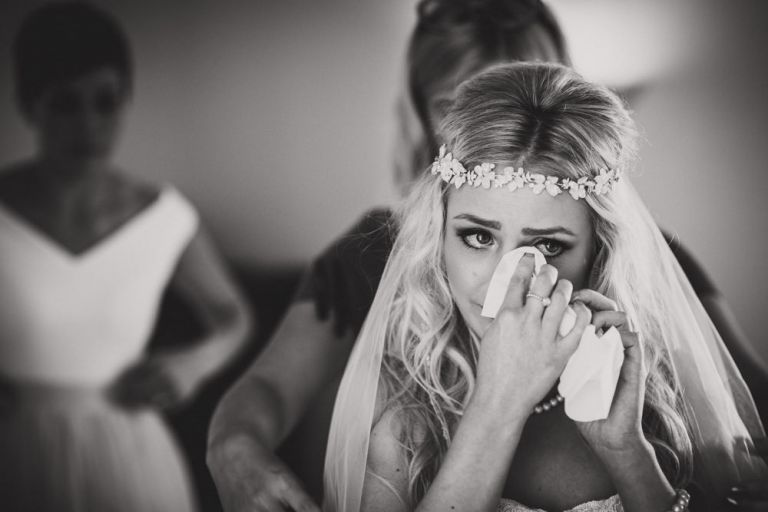 bride wiping tear