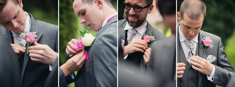 Grooms party putting on button holes