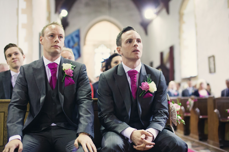 Groom waiting in church with best man