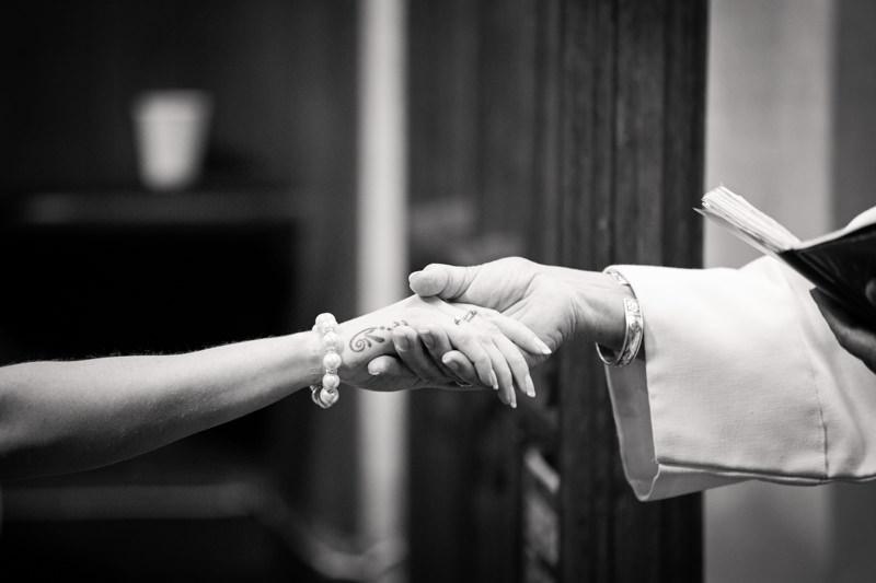 Vicar takes brides hand