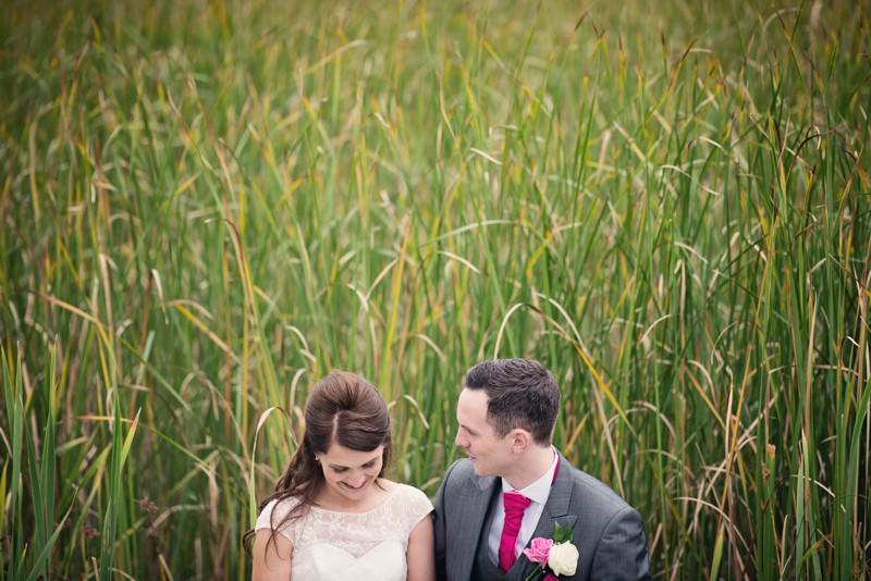 Bride and groom in front of reeds