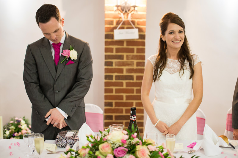 bride and groom enter wedding breakfast