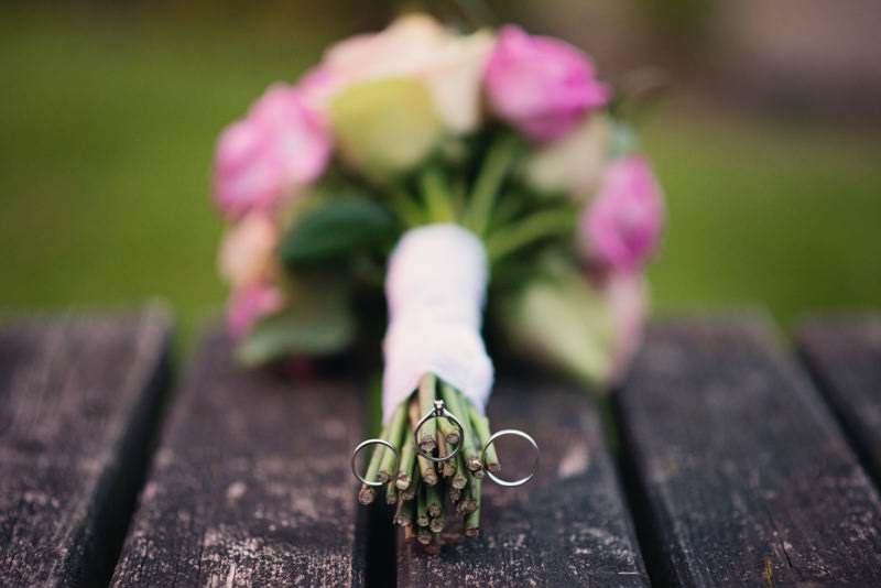 wedding rings on flower stems