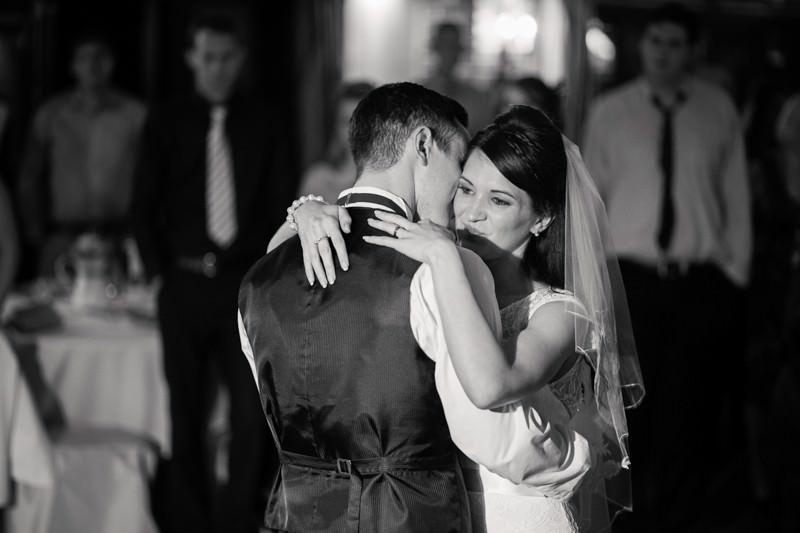 first dance bride looks over groom's shoulder