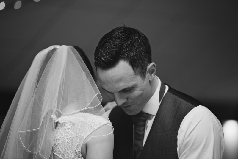 groom enjoys a moment with his bride