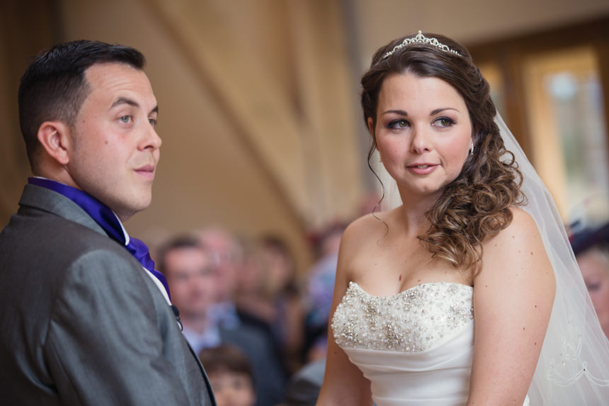 bride looking at registrar