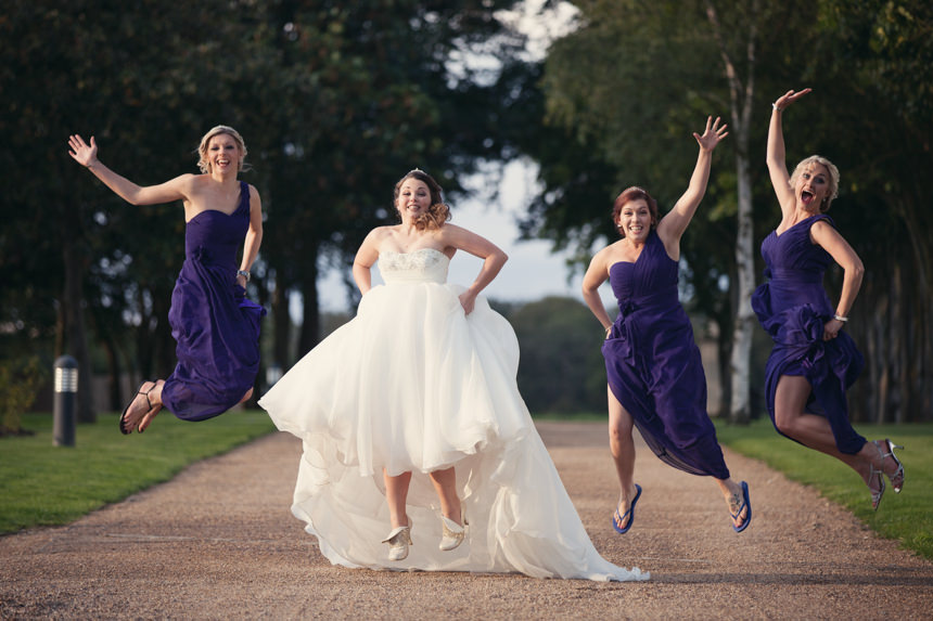 brides and bridesmaids jumping