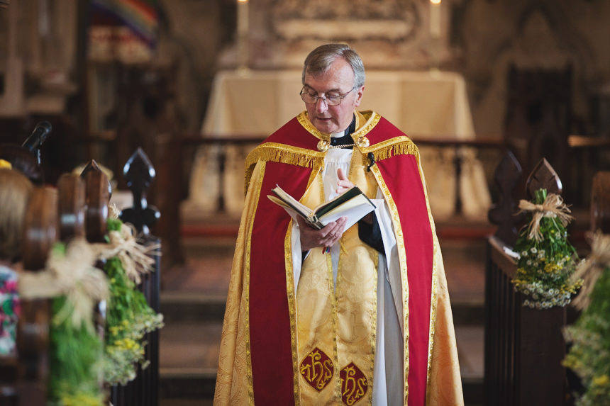 Reverend delivering service