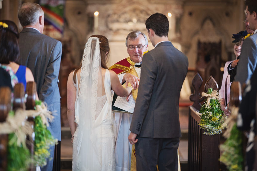 Vicar blessing the marriage