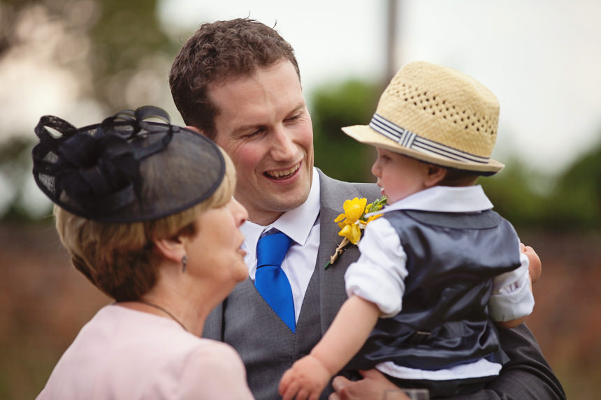 guest smiling at groom's son