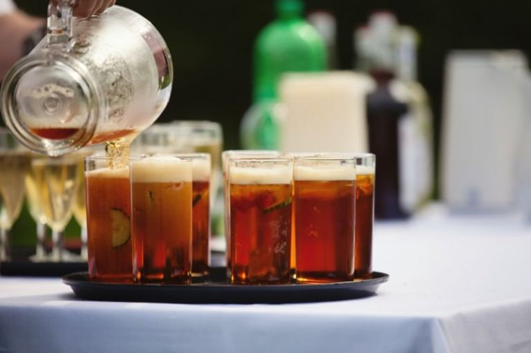 Glasses of pimms being poured