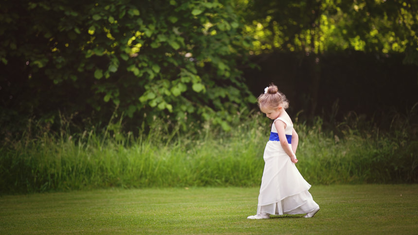 flower girl walking lost in her thoughts