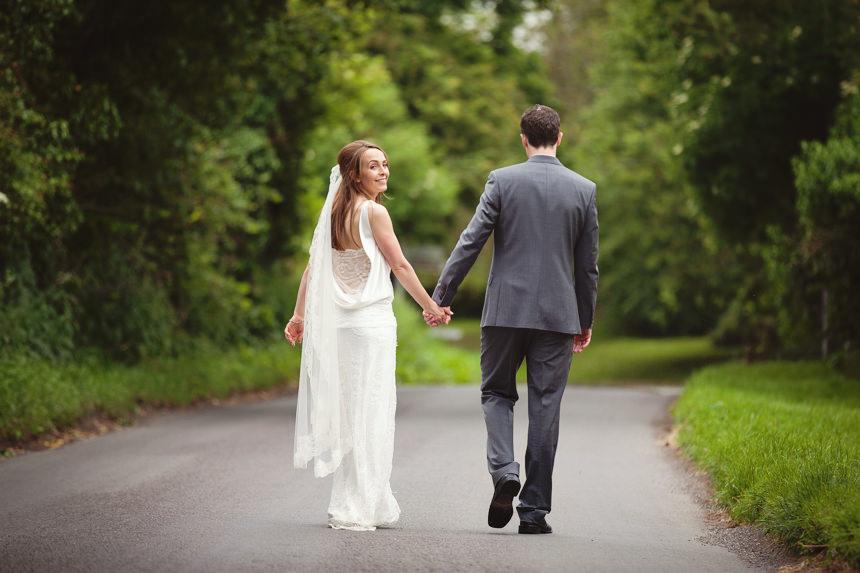 bride looking back while walking