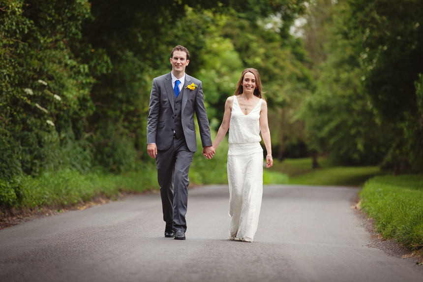 bride and groom walking towards camera