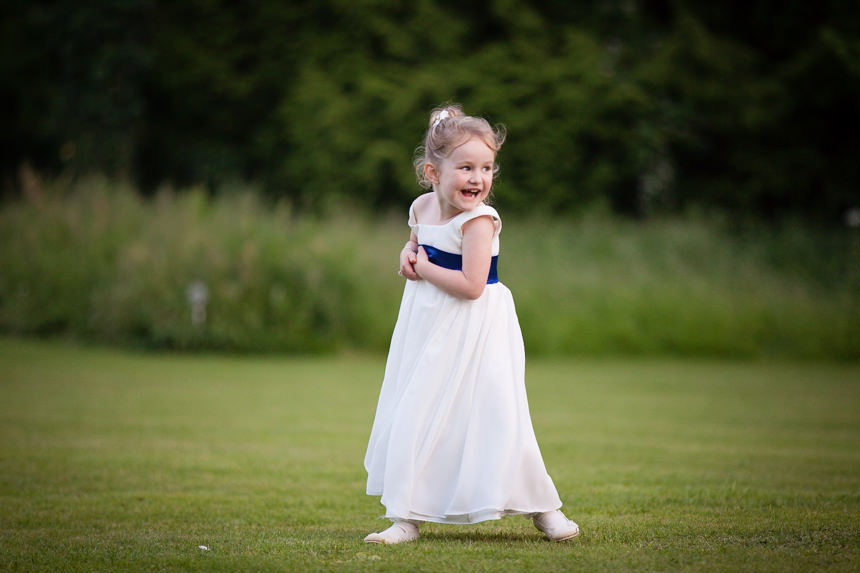 cheeky flower girl smiling