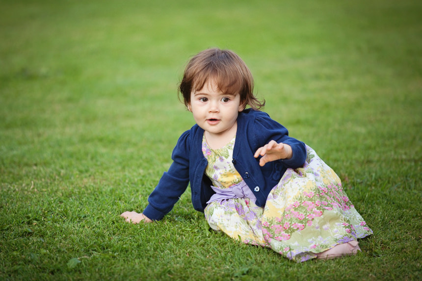 young guest from church sitting on lawn