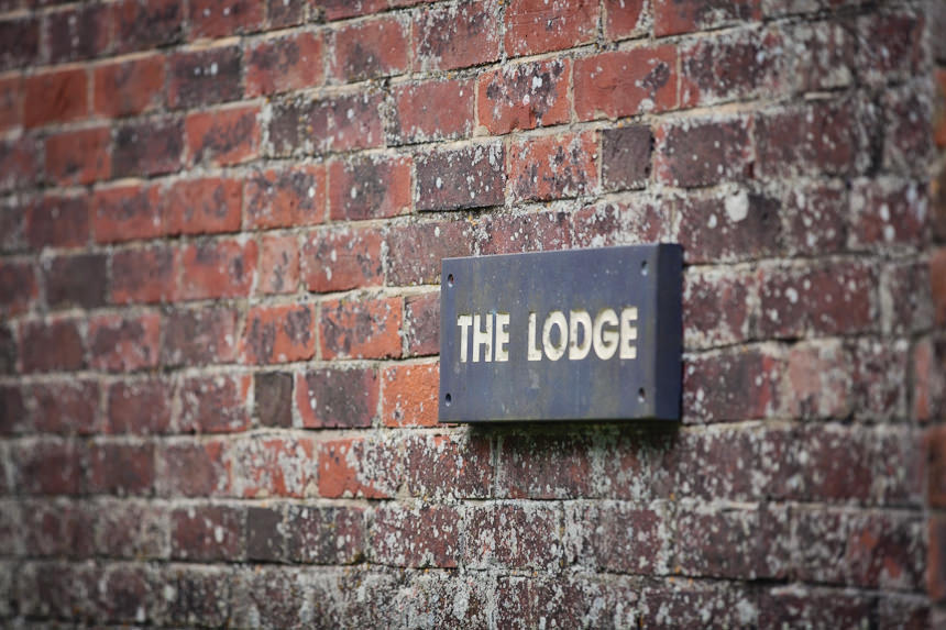 "venue gate sign ""the lodge"""