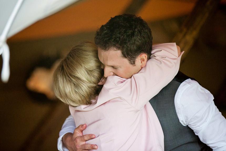 groom hugging his mother during speeches