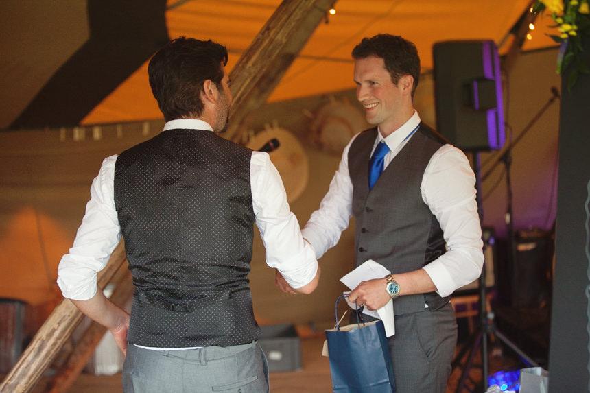groom thanking usher