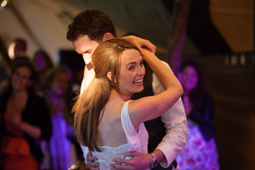 bride smiling while dancing