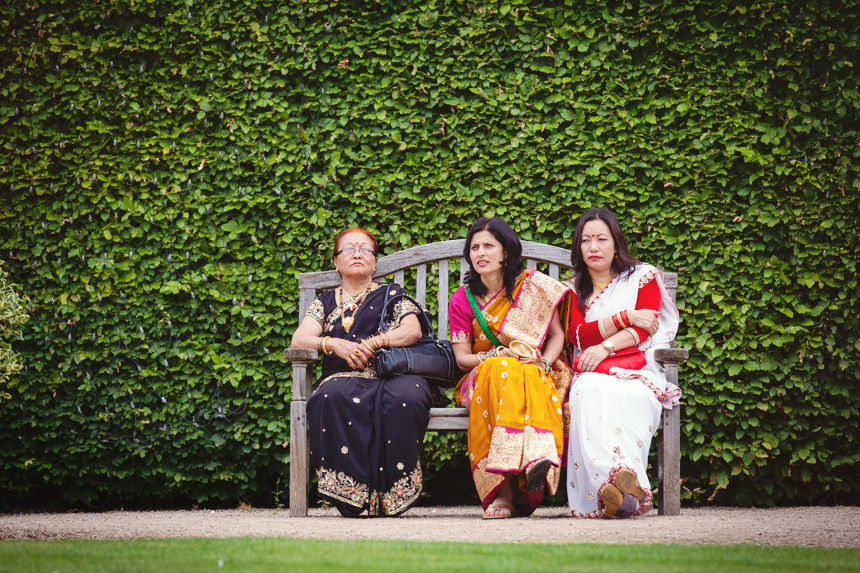 Three nepalese guests on bench