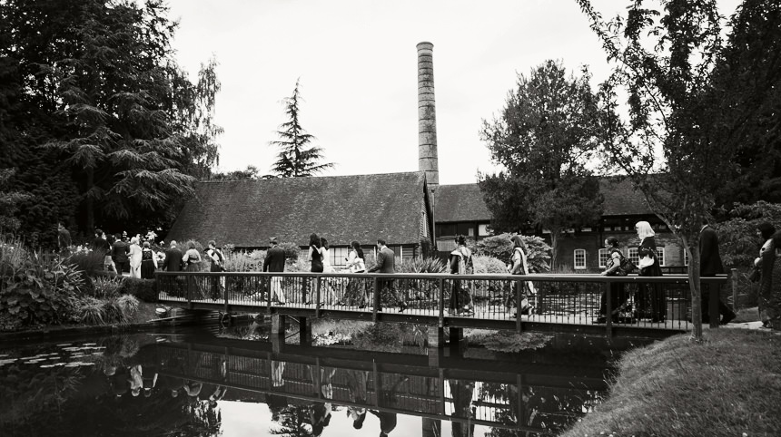 black and white shot of bridge with guests