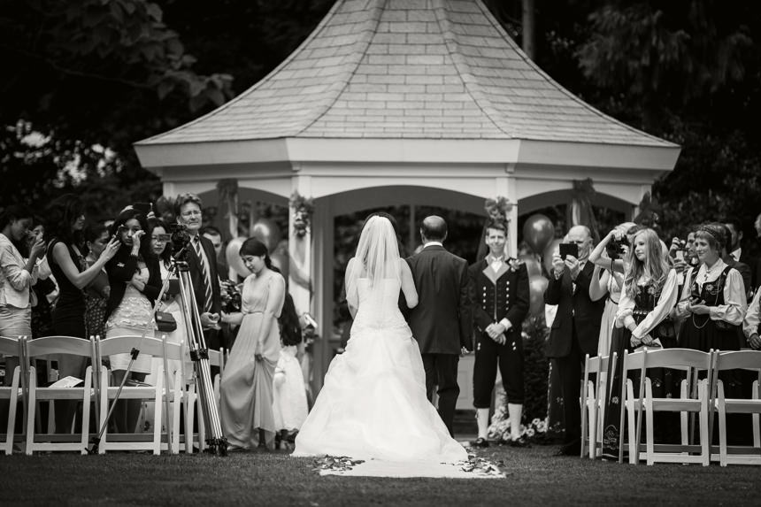 black and white bride and father walking down aisle