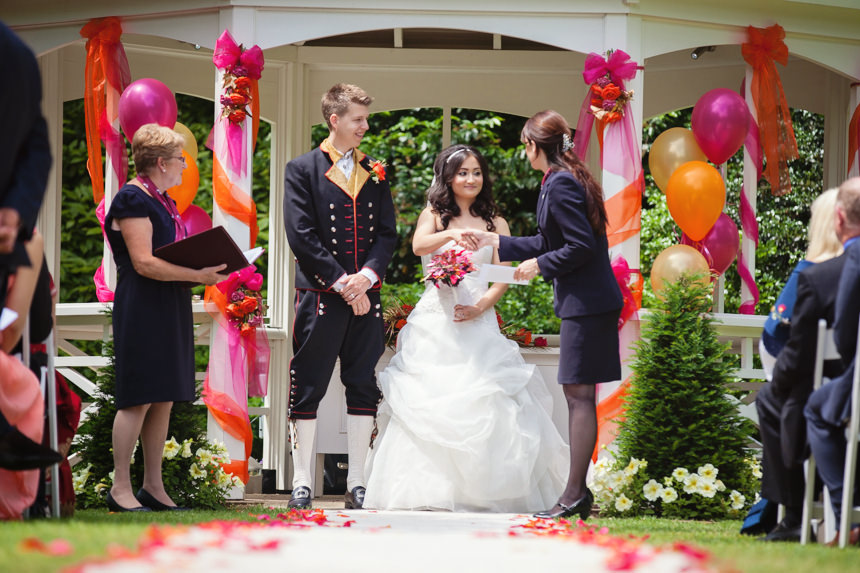 bride and groom receive marriage certificate