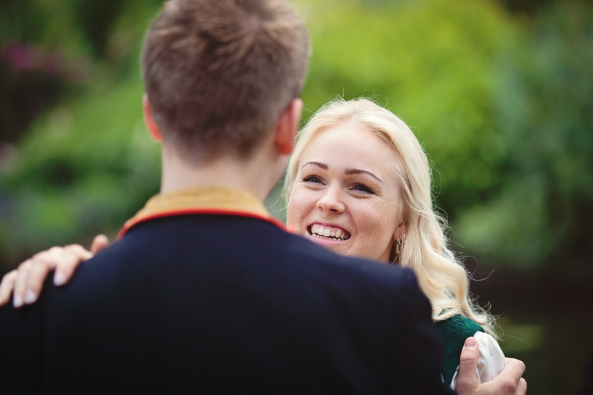 guest smiling at groom