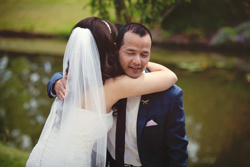 male guest hugs bride