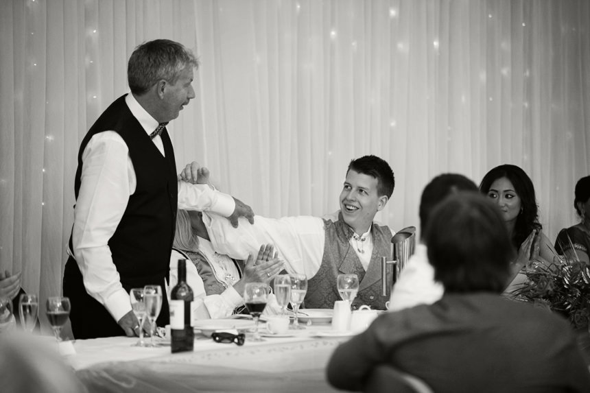 groom shares moment with his father