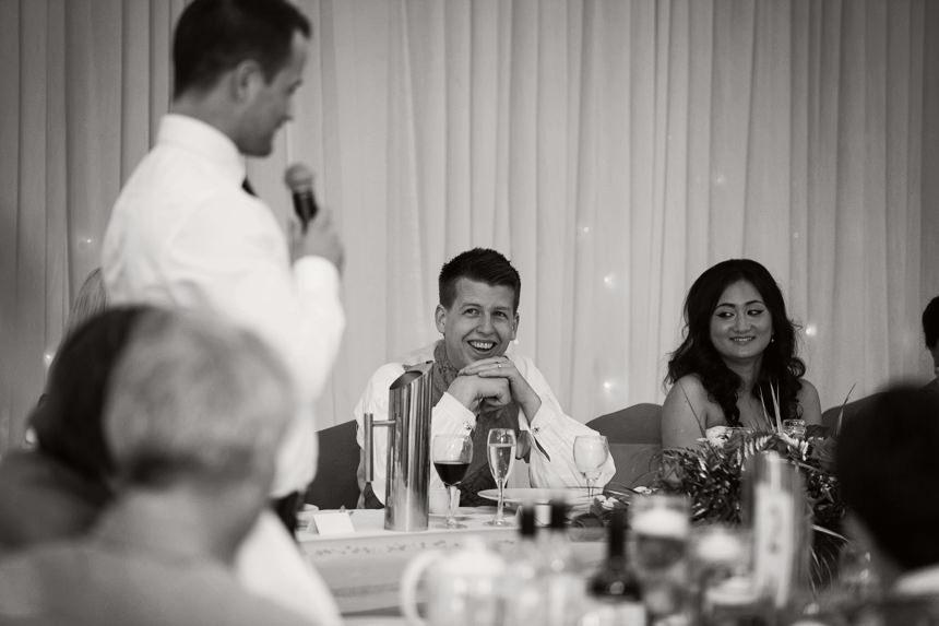 groom smiling at best man