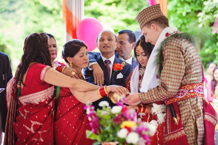 family gathers round bride and groom