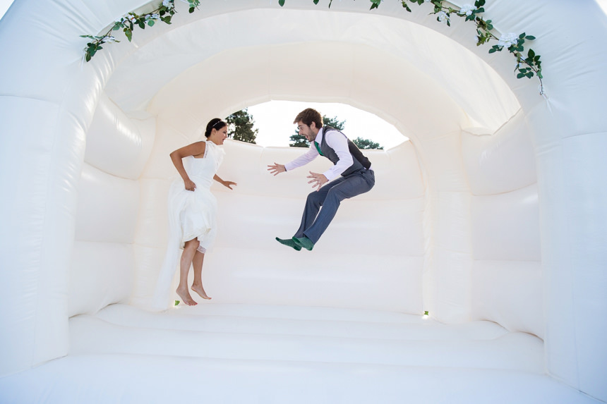 bride and groom bouncing