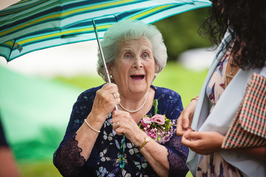 Grandmother holding umbrella