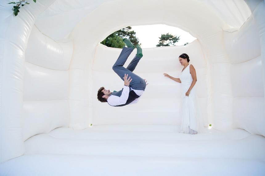 groom front flip on bouncy castle