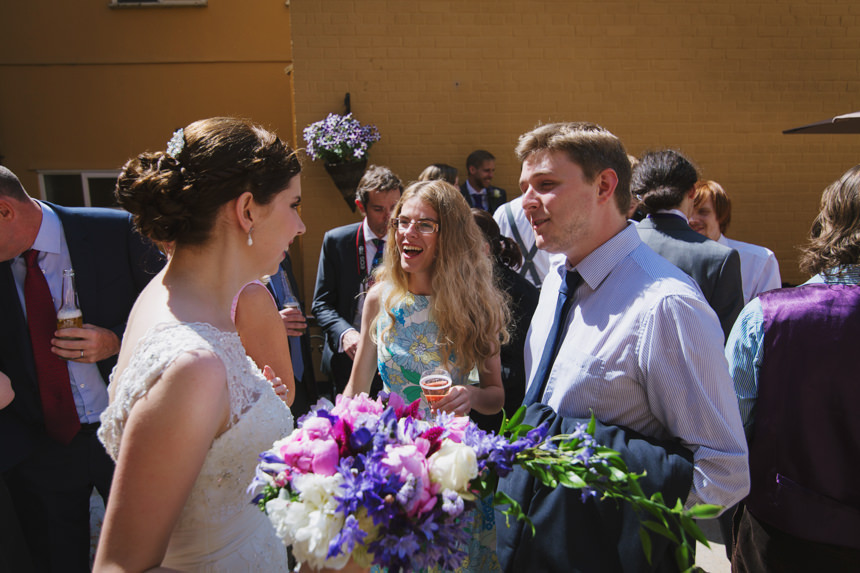 guests chatting with bride
