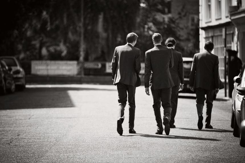 guys walking down road
