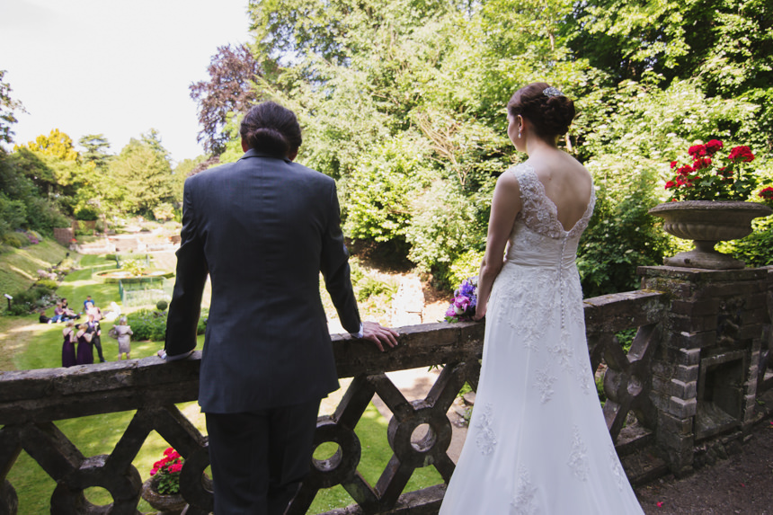 bride and groom looking out